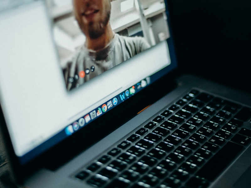 a man joins a video teleconference call