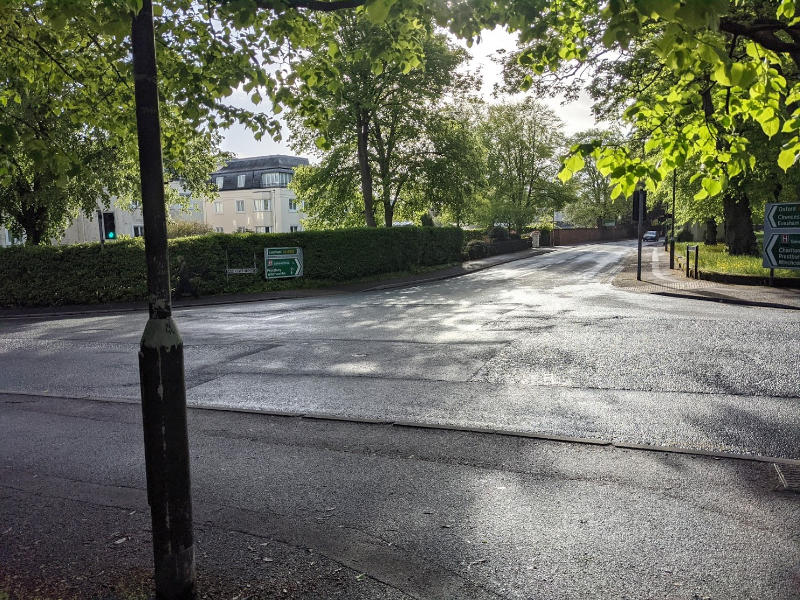 A picture of the bath road/sandford road junction showing lots of spare road space, but no through route for cyclists and no easy pedestrian crossing.