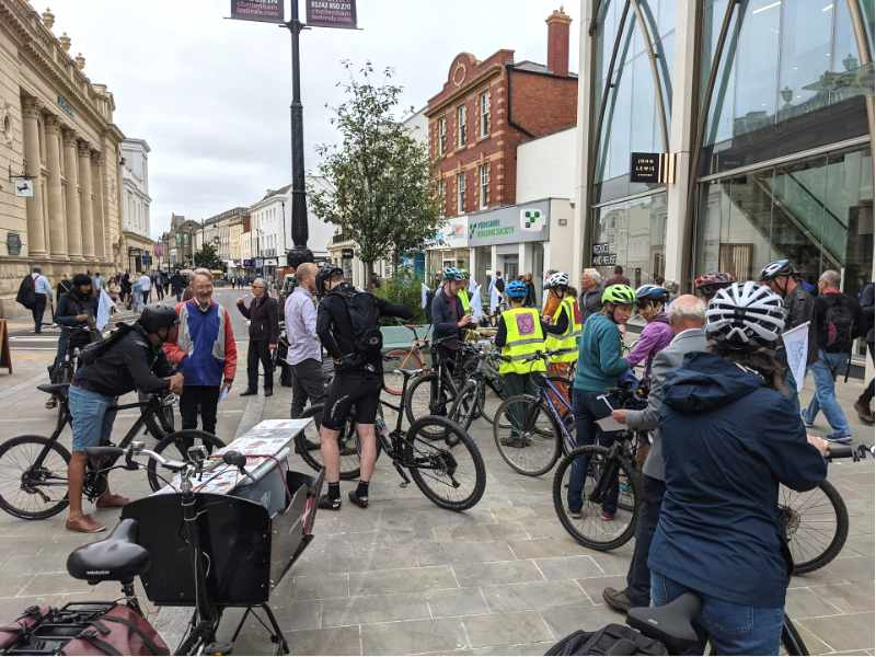 A group of cyclists gather for a ride through Cheltenham as part of Clean Air Day