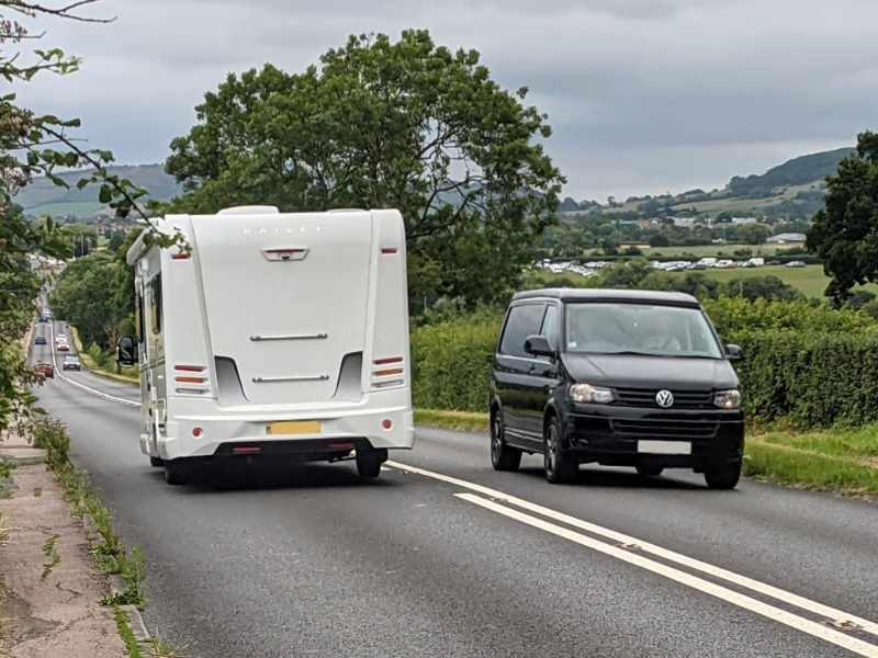 A photo of vehicles passing on the A435 near Cheltenham Racecourse. The Cheltenham to Bishop's Cleeve cycle route would provide an alternative to this road.